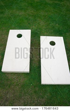Vertical Wooden Cornhole Boards from Above on Grass