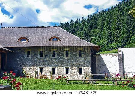 Moldova, Romania - July 4,  2014. Visiting Interior Garden Of An Old Monastery In Romanian Moldavian