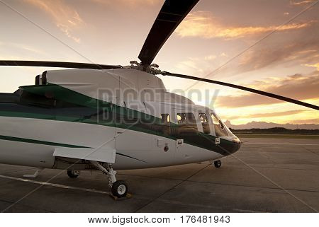 Photography of helicopter parked in hangar in the background sunset