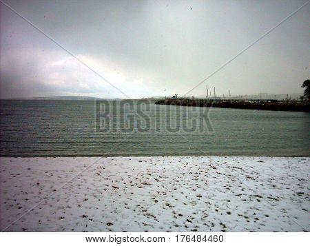NIeve en la playa en dia de febrero de 2006