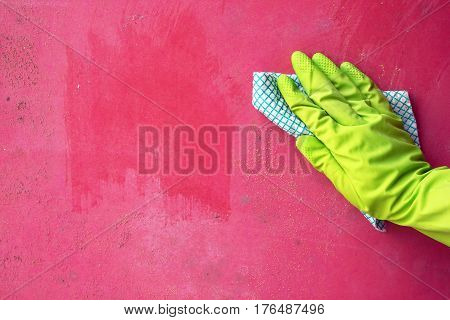 Close up of person hand cleaning mold fungus from wall using rag. Cleaning and hygiene in the house