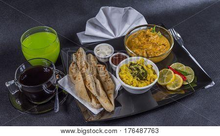 Oriental Indian Set, Chicken Korma, Naan Bread, Plate, Coffee, Green Drink, Napkin, Peppers, Sauces