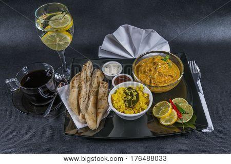 Oriental Indian Set, Chicken Korma, Naan Bread, Plate, Coffee, Water, Napkin, Peppers, Sauces