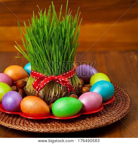 Colored eggs, wheat springs Nowruz Holiday in Azerbaijan. Selective focus.