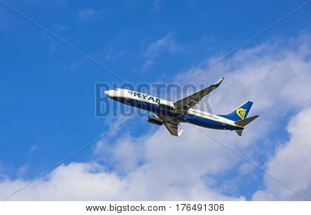 London UK - March 13 2017: Boeing 737-8AS (registration number: EI-DHA) operated by Ryanair flights in the sky over London city