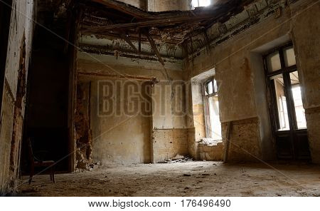 Empty room with chair in old ruined abandoned building, Odessa, Ukraine, Europe