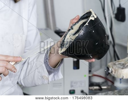 Dental Technician Is Working With A Dental Flask Of A Complete Upper On Cast
