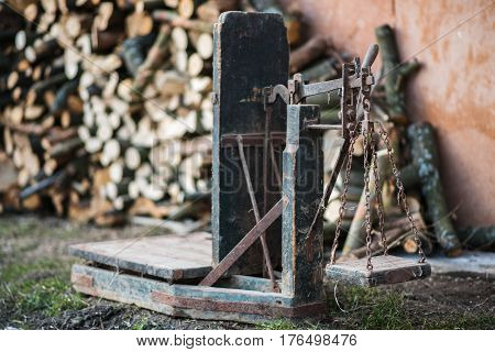 Ancient platform scales wood and iron weighing machine. Ukraine