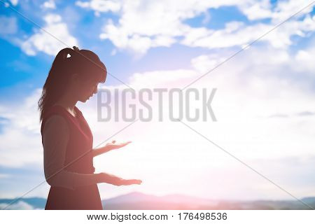 young woman pray pious with sunrise asian