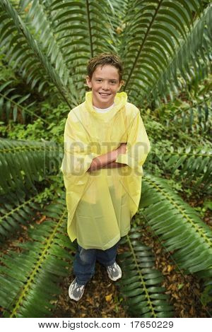 Boy Standing by Fern