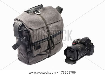 Professional photo-bag and a camera on a white background