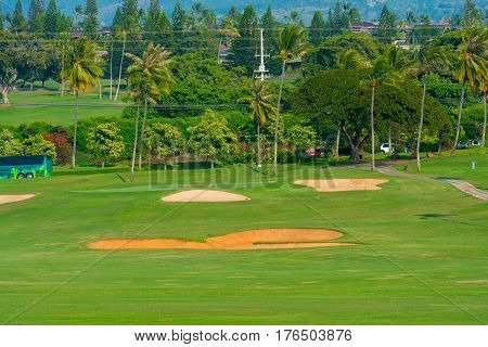 Green surrounded by sand traps on a beautiful golf course