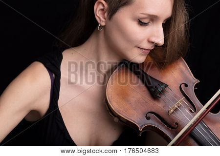 Beautiful Woman Playing Violin Studio Portrait On Black