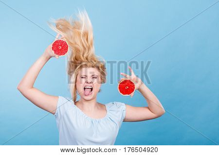 Woman Holding Red Grapefruit Having Crazy Windblown Hair