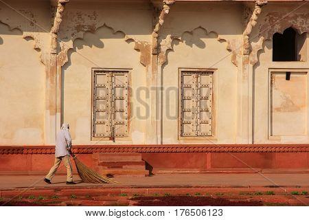 Worker Sweeping In Anguri Bagh (grape Garden) In Agra Fort, Uttar Pradesh, India