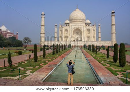 Tourist photographing Taj Mahal in Agra Uttar Pradesh India. It was build in 1632 by Emperor Shah Jahan as a memorial for his second wife Mumtaz Mahal.