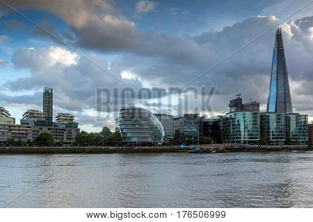 LONDON, ENGLAND - JUNE 15 2016: Sunset Panorama with The Shard skyscraper and Thames river, England, Great Britain