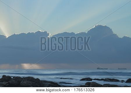Clouds with silver lining and the suns rays behind