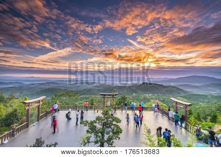 Lam Dong, Vietnam - February 17th, 2017: The magical of dawn on the yard 'Qui Phap Linh An' pagoda, which attracts many Buddhist to admire in Bao Loc town, Lam Dong province, Vietnam