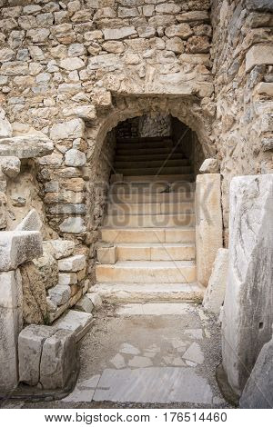 Steps and archway entrance to the odeon theatre in the ancient city of Ephesus Selcuk Turkey