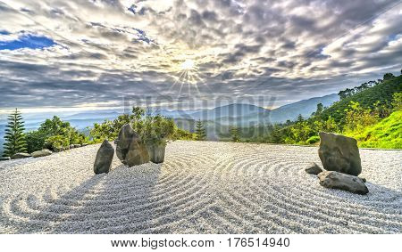 Lam Dong, Vietnam - February 17th, 2017: Rock garden with sun ray dawn welcoming a new day beautiful in Lam Dong, Vietnam