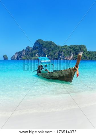 Longtail Boat Anchored At Ao Yongkasem Beach On Phi Phi Don Island, Krabi Province, Thailand