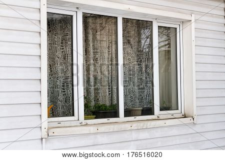 Large Plastic Window On The Wall Of Siding