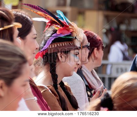 Nahariyya Israel March 10 2017 : Girl dressed in Indian woman's costume and made up like an Indian stands in the crowd and looks at the traditional annual carnival parade