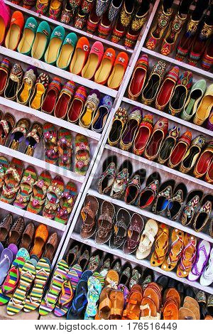 Display of shoes at the street market in Taj Ganj neighborhood of Agra Uttar Pradesh India. Agra is one of the most populous cities in Uttar Pradesh