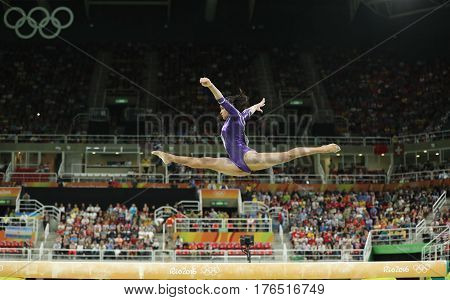 RIO DE JANEIRO, BRAZIL - AUGUST 11, 2016: Brazilian artistic gymnast Rebeca Andrade competes on the balance beam at women's all-around gymnastics at Rio 2016 Olympic Games