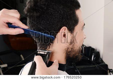 Man Having A Haircut With Hair Clippers.