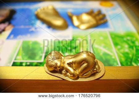 A small sculpture of a child from gypsum in gold!