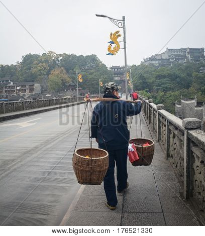 Vendor On Street In Phoenix Town In China