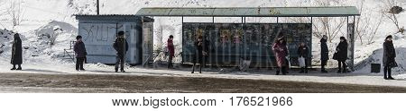 Kazakhstan, Ust-Kamenogorsk, march 7, 2017: People at the bus stop waiting for the bus
