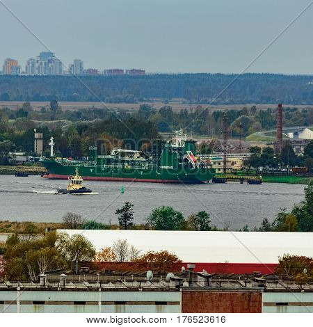 Tug Ship Moving Past The Cargo Port