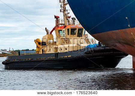 Tug Ship Towing Blue Bulk Carrier