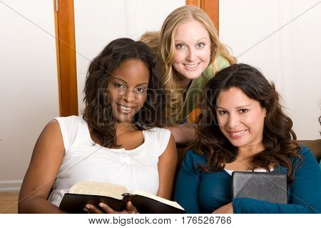 Diverse group of women studing The Bible.