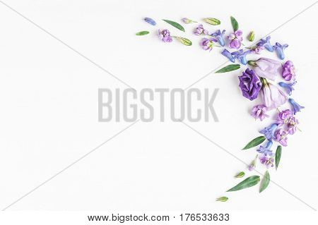 Flowers composition. Frame made of various colorful flowers on white background. Flat lay top view