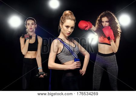 Attractive Sportswomen With Skipping Rope, Training With Dumbbells And Boxing On Black