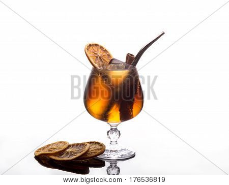 Fresh cocktail with coca-cola, ice, cinnamon and lemon on white background. Isolated coctail