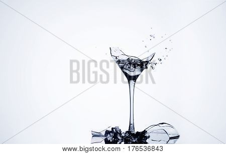Water splash in a broken goblet. Water drops in a glass. Shattered goblet