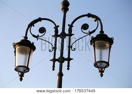 Antique Street light in Lazise on GAntique Street light on promenade in Lazise on Garda Lake. Italy