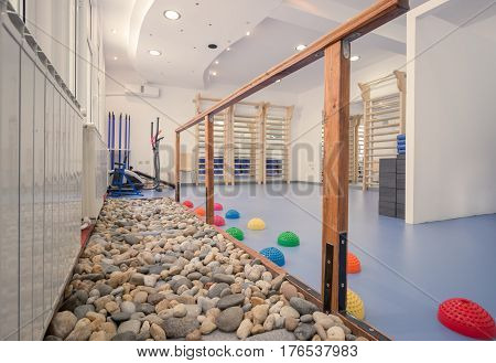 interior large room no people fitness gym physical therapy rocks equipment wall bars walking rocks