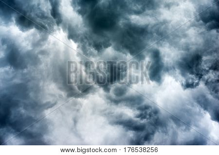 Beautiful dark ominous grey storm clouds. Dramatic sky like apocalypse