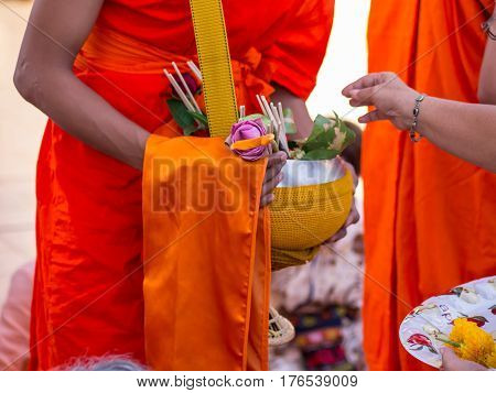 Offer sacrifice flowers to monk, Buddhist  religion