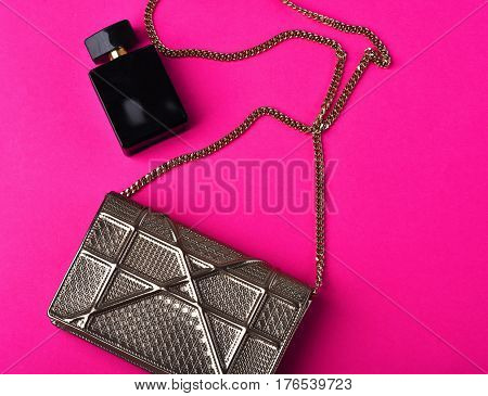 Small Womans Metallized Silver Bag With Metallic Chain Near Perfume