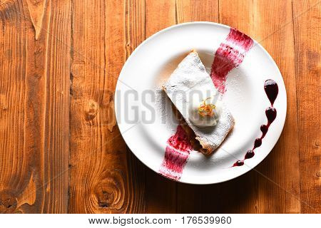 Delicious Apple Strudel With Vanilla Ice Cream And Berry Sauce