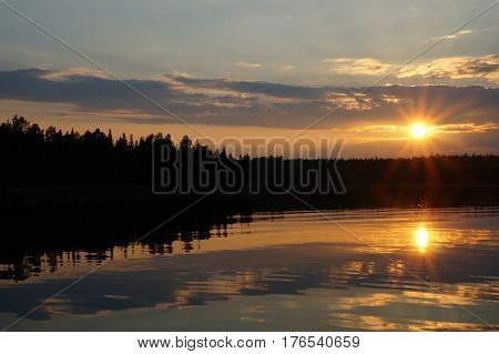 Picture of sunset at lake near foot of mountains