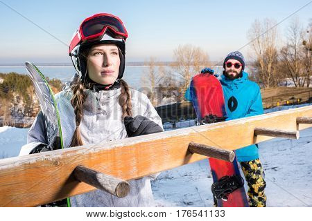 Male And Female Snowboarders