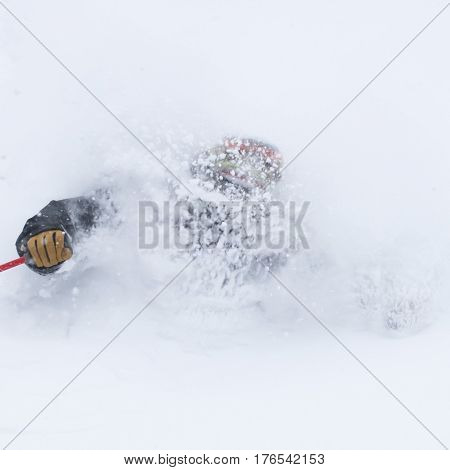 A freerider running in a snow powder